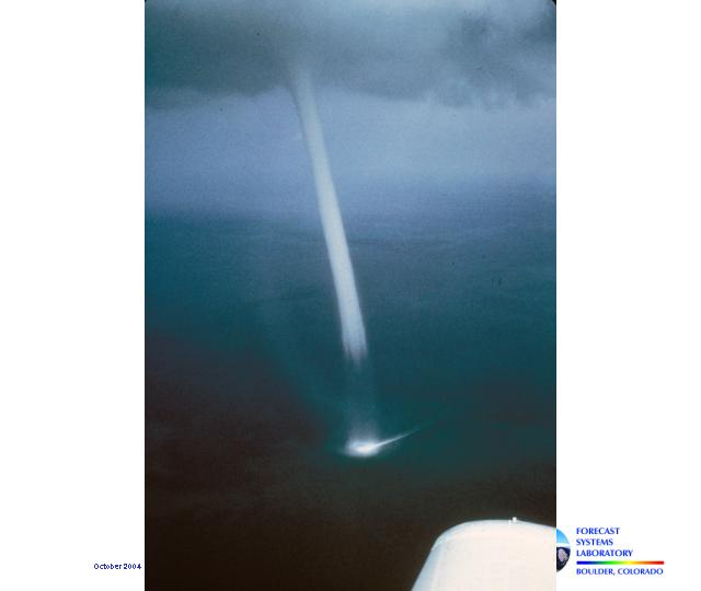 The image shows a well-defined waterspout.