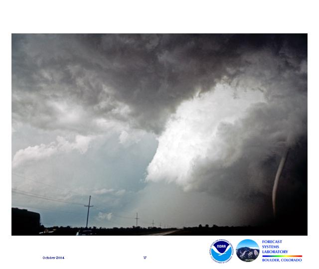 This view of the Union City, Oklahoma tornado on May 24, 1973 shows a lowered wedge-shaped cloud base with a rope funnel descending from it.