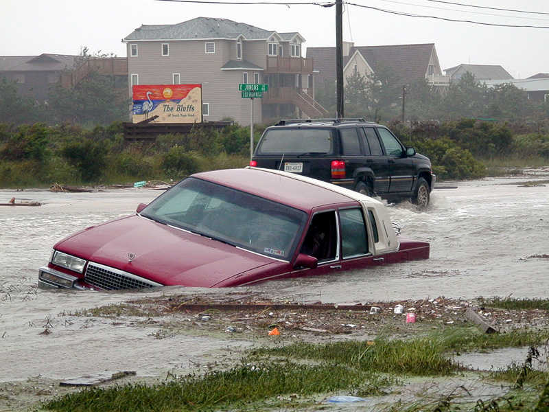Car swept off the road by flood waters