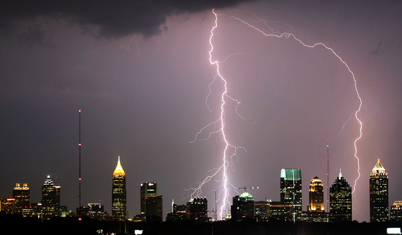Lightning striking tall buildings