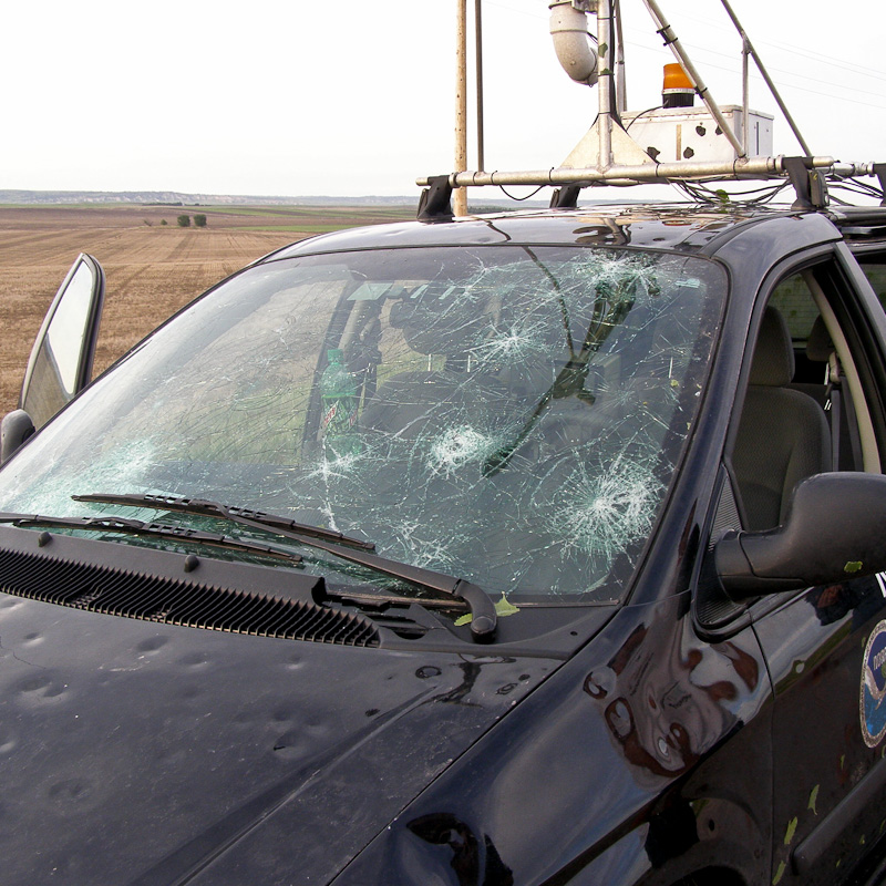 Hail damage to chase vehicle