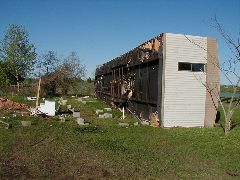 Mobile home that has been blown over by straight line winds