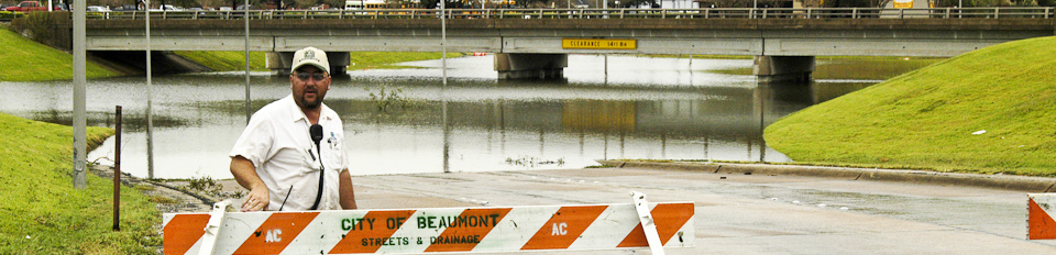 Flooded underpass with road block signs