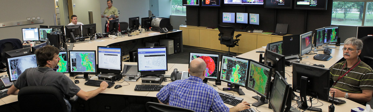 Forecast meteorologists at work in the Norman, OK Weather Service Forecast Office
