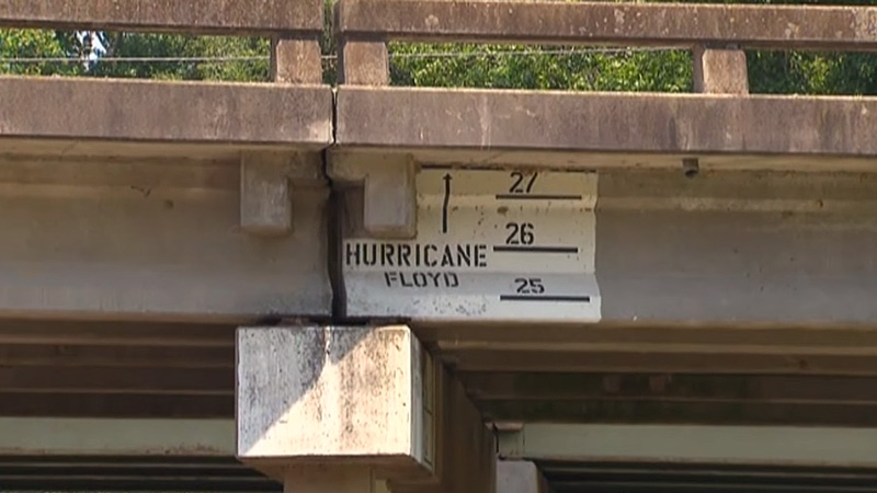 Hurricane Floyd water levels marked on freeway overpass