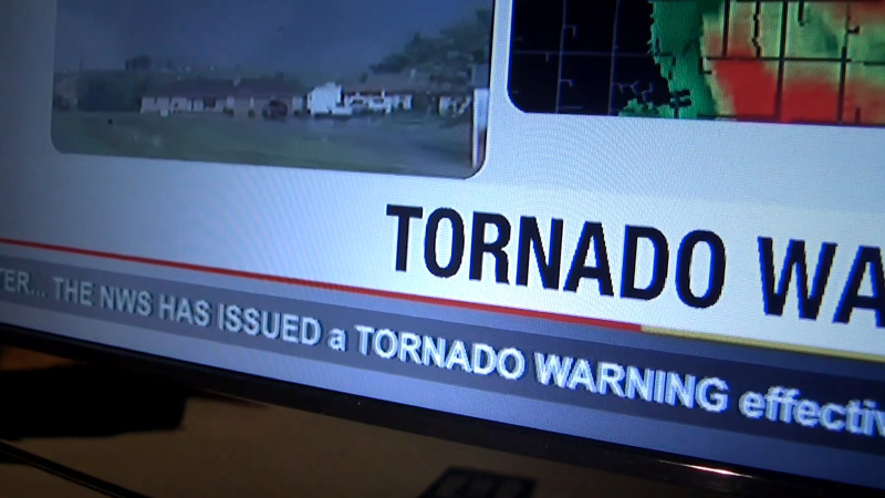 Tornado warning message on a television