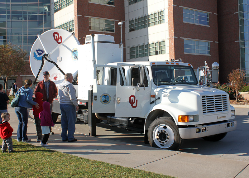 Visitors look at mobile radar vehicle