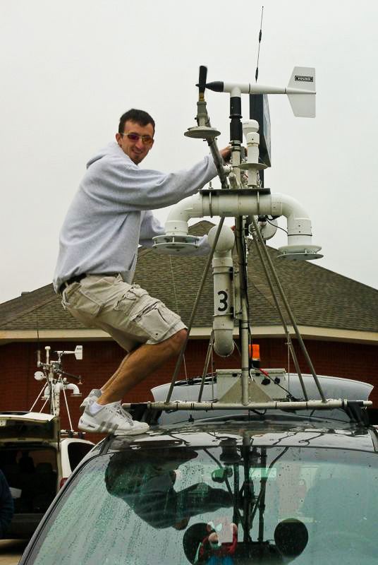 Sean Waugh adjusts equipment on mobile mesonet