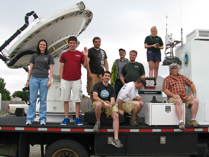 VORTEX2 student researchers wave from the back of a radar truck